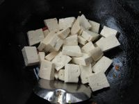 put tofu into pan
